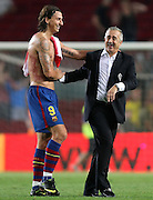 FC Barcelona's Zlatan Ibrahimovic (l) and Sporting de Gijon's coach Manuel Preciado after La Liga match.August 31 2009.