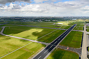 Nederland, Noord-Holland, Schiphol, 28-04-2017; zicht op de - weinig gebruikte - Oostbaan van Schiphol.<br /> View of the - little used - Oostbaan van Schiphol.<br /> luchtfoto (toeslag op standaard tarieven);<br /> aerial photo (additional fee required);<br /> copyright foto/photo Siebe Swart