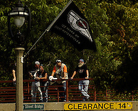 Harley Davidson fans watch from a bridge top as bikers ride along Lake Drive Friday Aug. 29, 2003 Milwaukee. Thousands of Harley Davidson bikers from all over the world came to Wisconsin to help celebrate Harley Davidson 100th anniversary.   photo by Darren Hauck