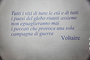 "A quote from ""War"" by Voltaire, All the united vices of all ages and places will never equal the evils produced by a single campaign. in Italian, inside the Camposanto Monumentale cemetery. Pisa, Tuscany, Italy."