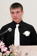 Jordan Flynn delivers welcoming remarks during the 8th grade recognition ceremony at Cleveland PK-8 School in Dayton, May 25, 2012.