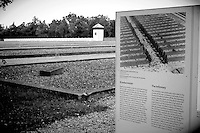 "Dachau concentration camp was the first Nazi concentration camp opened in Germany, located on the grounds of an abandoned munitions factory near the medieval town of Dachau, about 16 km northwest of Munich in the state of Bavaria, which is located in southern Germany. Opened 22 March 1933 (51 days after Hitler took power), it was the first regular concentration camp established by the coalition government of the National Socialist Party (Nazi Party) and the German Nationalist People's Party. Heinrich Himmler, then Chief of Police of Munich, officially described the camp as ""the first concentration camp for political prisoners."""
