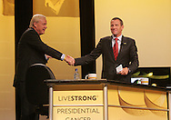 28 August 2007: MSNBC Hardball host Chris Matthews (left) and seven-time Tour de France winner Lance Armstrong (right) shake hands at the end of the LIVESTRONG Presidential Cancer Forum in Cedar Rapids, Iowa on August 28, 2007.
