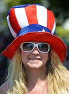 WARMINSTER, PA - MAY 26:  Gina Stevens wears an American flag hat while marching in the Warminster Memorial Day Parade and Ceremony May 26, 2014 in Warminster, Pennsylvania. (Photo by William Thomas Cain/Cain Images)