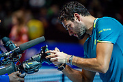 Matteo Berrettini of Italy signs the tv camera lens after winning his match during the Nitto ATP Finals at the O2 Arena, London, United Kingdom on 14 November 2019.