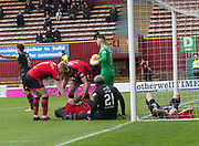28th April 2018, Fir Park, Motherwell, Scotland; Scottish Premier League football, Motherwell versus Dundee; Genseric Kusunga of Dundee gets injured while scoring for 1-0