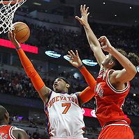 12 March 2012: New York Knicks small forward Carmelo Anthony (7) goes for the layup past Chicago Bulls center Joakim Noah (13) during the Chicago Bulls 104-99 victory over the New York Knicks at the United Center, Chicago, Illinois, USA.