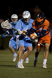 Virginia Cavaliers A/M Danny Glading (9) in action against UNC.  The Virginia Cavaliers Men's Lacrosse Team defeated the North Carolina Tar Heels 10-9 in overtime at Klockner Stadium in Charlottesville, VA on April 7, 2007.