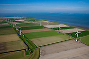 Nederland, Groningen, Eemsmond, 08-09-2009; windmolenpark in de Emmapolder, Eemspolder geheel links, de traditionele windmolen Goliath in de voorgrond. Energy Park van elektriciteitsbedrijf Essent is het grootste windmolenpark van Nederland..Waddenzee met Uithuizerwad, aan de horizon Rottumeroog en Borkum (r).Wind farm in polder of the  northeast of province of Groningen, the traditional windmill Goliath in the foreground. Energy Park (from Essent) is the largest wind farm in the Netherlands..Wadden sea with Uithuizerwad, at the horizon with Rottumeroog and Borkum (r).luchtfoto (toeslag); aerial photo (additional fee required); .foto Siebe Swart / photo Siebe Swart
