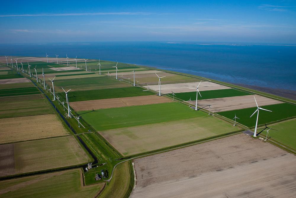 Nederland, Groningen, Eemsmond, 08-09-2009; windmolenpark in de Emmapolder, Eemspolder geheel links, de traditionele windmolen Goliath in de voorgrond. Energy Park van elektriciteitsbedrijf Essent is het grootste windmolenpark van Nederland..Waddenzee met Uithuizerwad, aan de horizon Rottumeroog en Borkum (r).Wind farm in polder of the  northeast of province of Groningen, the traditional windmill Goliath in the foreground. Energy Park (from Essent) is the largest wind farm in the Netherlands..Wadden sea with Uithuizerwad, at the horizon with Rottumeroog and Borkum (r).luchtfoto (toeslag); aerial photo (additional fee required); .foto Siebe Swart / photo Siebe Swart