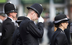 © Licensed to London News Pictures. 10/04/2017. London, UK. An officer lowers his head as the funeral cortege carrying the coffin of policeman Keith Palmer from Southwark passes by after a service was held at the cathedral. PC Palmer was murdered just inside the main gates of Parliament by Westminster attacker Khalid Masood - an attack in which he also killed four people on Westminster Bridge. PC Palmer's funeral will take place at Southwark Cathedral today. Photo credit: Peter Macdiarmid/LNP