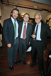 Left to right, ALEX MAVROS, LORD DALMENY and DR IAIN DOUGLAS-HAMILTON at a reception in aid of Save The Elephants held at Patrick Mavros, 104-106 Fulham Road, Lodon SW3 on 23rd September 2009.