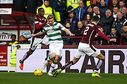 Celtic FC Midfielder Stuart Armstrong plays the ball forward during the Ladbrokes Scottish Premiership match between Heart of Midlothian and Celtic at Tynecastle Stadium, Gorgie, Scotland on 27 December 2015. Photo by Craig McAllister.