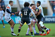 Newcastle Falcons Number 8 Nili Latu (8) held in the tackle  during the Aviva Premiership match between Newcastle Falcons and Leicester Tigers at Kingston Park, Newcastle, United Kingdom on 29 October 2017. Photo by Simon Davies.