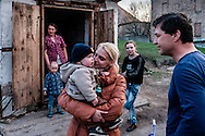 "12 of April 2015 / Petrovski/ Donetsk Oblast/ Ukraine - Tomas Vlach (on the right) emergency coordinator for the NGO ""People in Need"" welcome by some members of families living in the bunker."