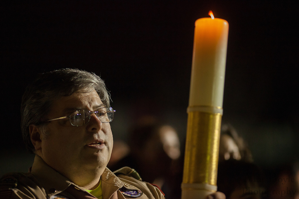 Bob Foley, committee chair and chaplain at Boy Scout Troop 177, holds the Peace Light during Gloucester Township Third Annual Tree Lighting  at Veterans Park in Gloucester Township, NJ on Sunday December 16, 2012.  The Peace Light is a flame from the Grotto of the Nativity in Bethlahem, the site where Jesus was believed to be born,  that is spread around the world to promote peace. (photo / Mat Boyle)