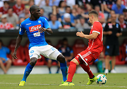 Napoli's Kalidou Coulibaly (left) and Bayern Munich's Mario Crnicki battle for the ball