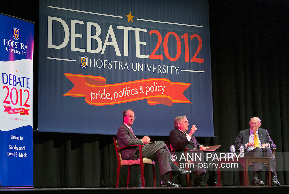 """Oct. 15, 2012 - Hempstead, New York, U.S. - At left, former White House Chief of Staff ERSKINE BOWLES (Democrat), and, at right, former Senator ALAN SIMPSON (Republican), co-chairmen of the National Commission on Fiscal Responsibility and Reform, speak at Hofstra University about ?America's Debt and Deficit Crisis: Issues and Solutions,? with (at center) moderator PATRICK SOCCI, Dean of Hofstra's Zarb School of Business. This event with the Simpson-Bowles non-partisan U.S. fiscal debt reduction plan co-leaders, was part of """"Debate 2012 Pride Politics and Policy"""" a series of events leading up to when Hofstra hosts the 2nd Presidential Debate between Obama and M. Romney, the next night, October 16, 2012, in a Town Meeting format."""