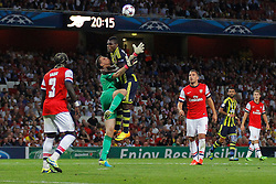27.08.2013, Emirates Stadion, London, ENG, UEFA CL Qualifikation, FC Arsenal vs Fenerbahce Istanbul, Rueckspiel, im Bild Arsenal's Wojciech Szczesny is fouled by Fernerbache's Emmanuel Emenike during the UEFA Champions League Qualifier second leg match between FC Arsenal and Fenerbahce Istanbul at the Emirates Stadium, United Kingdom on 2013/08/27. EXPA Pictures © 2013, PhotoCredit: EXPA/ Mitchell Gunn<br /> <br /> ***** ATTENTION - OUT OF GBR *****