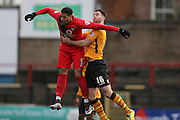 York City forward Vadaine Oliver  and Newport County defender Andrew Hughes   during the Sky Bet League 2 match between York City and Newport County at Bootham Crescent, York, England on 16 January 2016. Photo by Simon Davies.