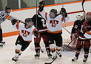 2012/03/04 - RIT's Kourtney Kunichika and Kolbee McCrea celebrate RIT's second goal in the closing seconds of the second period of the ECAC West Championship game between RIT and SUNY Plattsburgh at RIT's Ritter Arena on March 4th, 2012. RIT lead 2-1 after two periods of play.
