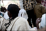 "Jerusalem at her wedding. She is a really young bride of 8 years old, and she is being married with a guy 10 years older. Moments during the Orthodox function, celbrated in a small village. In Ethiopia 60 percent of girls younger than 18 are married. In the Amhara region, half of girls younger than 15 are married. In forced marriage, the parents choose their son's or daughter's future spouse with no input from the son or daughter. North West of Ethiopia, on saturday, Febrary 14 2009.....In a tangled mingling of tradition and culture, in the normal place of living, in a laid-back attitude. The background of Ethiopia's ""child brides"", a country which has the distinction of having highest percentage in the practice of early marriages despite having a law that establishes 18 years as minimum age to get married. Celebrations that last days, their minds clouded by girls cups of tella and the unknown for the future. White bridal veil frame their faces expressive of small defenseless creatures, who at the age ranging from three to twelve years shall be given to young brides men adults already...To protect the identities of the recorded subjects names and specific places are fictional."