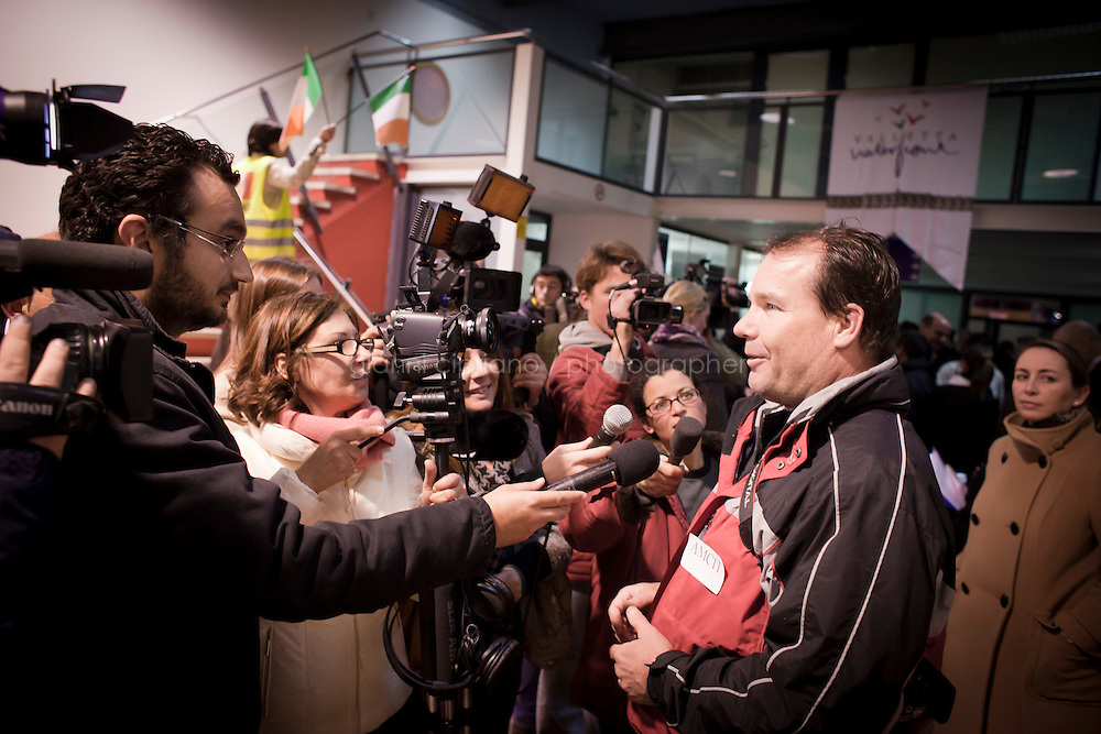 25 February 2011. Valletta, Malta. A man evacuated from Libya is here interviewed by a TV crew. A U.S.-chartered ferry evacuated Americans and other foreigners out of Libya on Friday and brought them to the Mediterranean island of Malta. The Maria Dolores ferry, after three days of delays, brought over 300 passengers, including at 167 U.S. citizens, away from Libya where Colonel Gaddafi's forces continue to clash with anti-government demonstrators.<br /> <br /> <br /> &copy;2011 Gianni Cipriano<br /> cell. +1 646 465 2168 (USA)<br /> cell. +39 328 567 7923<br /> gianni@giannicipriano.com<br /> www.giannicipriano.com