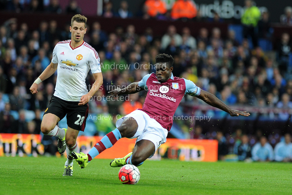 Micah Richards of Aston Villa &reg; holds off Morgan Schneiderlin of Manchester Utd.  Barclays Premier League match, Aston Villa v Manchester Utd at Villa Park in Birmingham, Midlands on Friday 14th August  2015.<br /> pic by Andrew Orchard, Andrew Orchard sports photography.