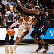 17 January 2018: San Diego State Aztecs guard Devin Watson (0) drives the ball into the paint against a Fresno State defender in the second half. San Diego State dropped a tough game to Fresno State 77-73 at Viejas Arena. <br /> More game action at www.sdsuaztecphotos.com