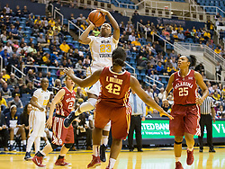 West Virginia Mountaineers guard Bria Holmes (23) shoots over Oklahoma Sooners forward Kaylon Williams (42) during the second half at the WVU Coliseum.