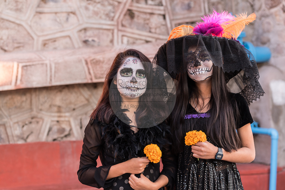 Teenagers dressed as La Calavera Catrina for Day of the Dead festival in San Miguel de Allende, Guanajuato, Mexico. The week-long celebration is a time when Mexicans welcome the dead back to earth for a visit and celebrate life.