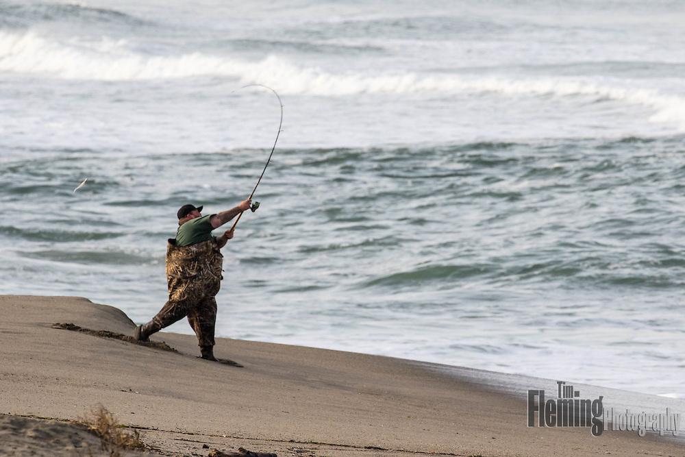 A surf fisherman tries his luck in the Pacific Ocean near Santa Cruz, California