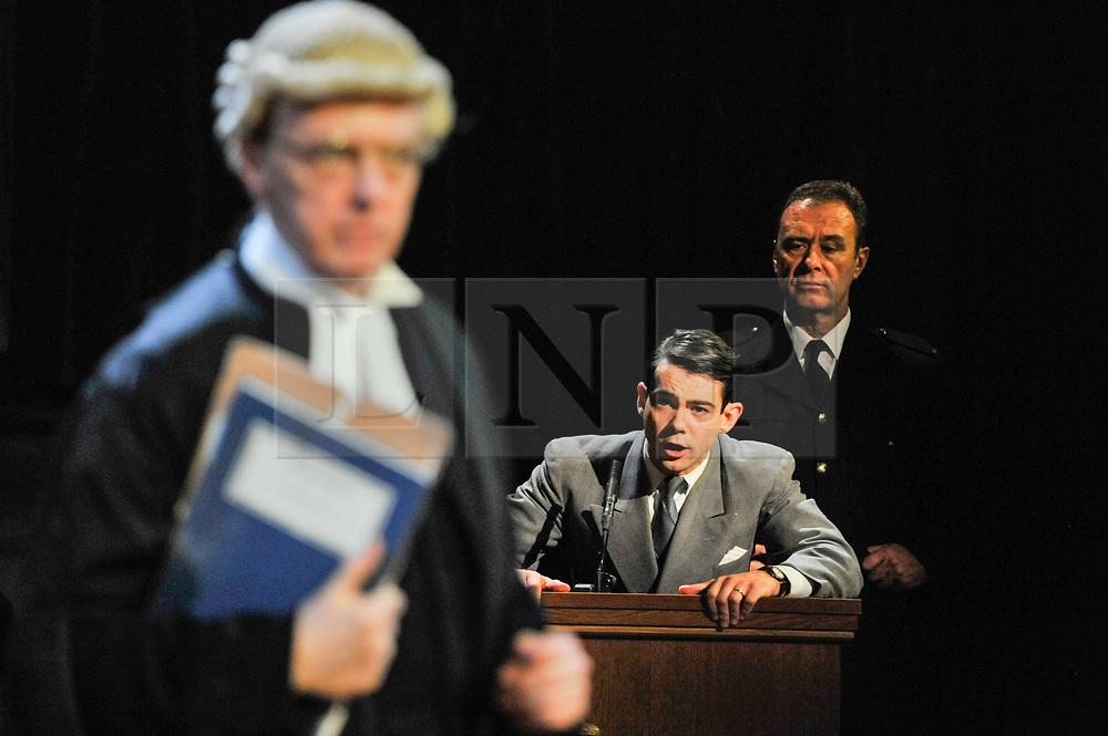 """© Licensed to London News Pictures. 20/10/2017. London, UK. Jack McMullen as Leonard Vole, the accused, in the witness stand.  Photocall for """"Witness for the Prosecution"""", by Agatha Christie, directed by Lucy Bailey, at London County Hall.  The play opens 23 October. Photo credit : Stephen Chung/LNP"""