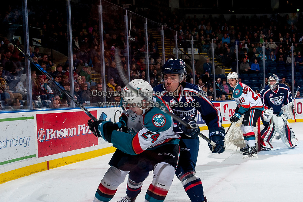 KELOWNA, CANADA - JANUARY 3: Dylan Coghlan #10 of the Tri-City Americans back checks Kyle Topping #24 of the Kelowna Rockets at the boards on January 3, 2017 at Prospera Place in Kelowna, British Columbia, Canada.  (Photo by Marissa Baecker/Shoot the Breeze)  *** Local Caption ***