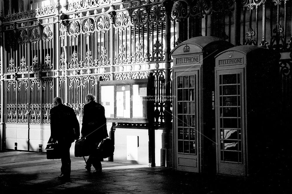 men walk home from work through smithfields market london.