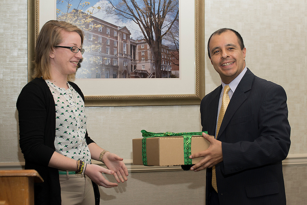 Senior Cutler Scholar Caitlyn John presents a gift to her mentor Dr. Julio Arauz. John comments that Dr. Arauz, an Assitant Professor in the J. Warren McClure School of Information and Telecommunication Systems. © Ohio University / Photo by Olivia Wallace