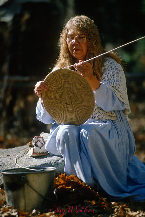 Julia Parker works on one of her handwoven baskets at the Yosemite Museum.  She has been a Cultural Specialist at the Yosemite Miwok Indian Village in the park since 1960.