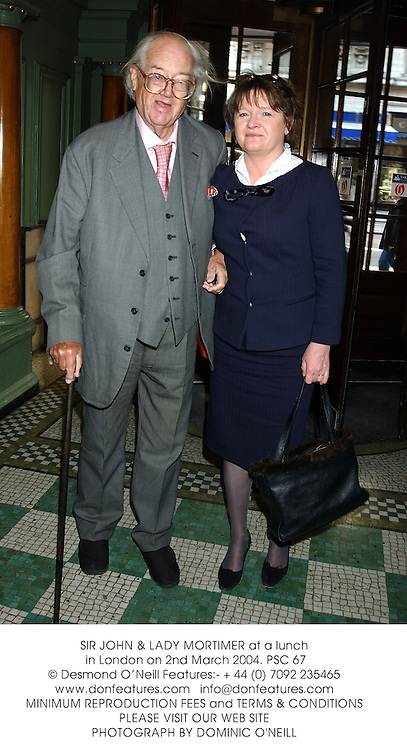 SIR JOHN & LADY MORTIMER at a lunch in London on 2nd March 2004.PSC 67