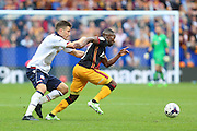 Bradford City midfielder Mark Marshall (7) gets away from Bradford City defender Stephen Darby (2) during the EFL Sky Bet League 1 match between Bolton Wanderers and Bradford City at the Macron Stadium, Bolton, England on 24 September 2016. Photo by Simon Brady.