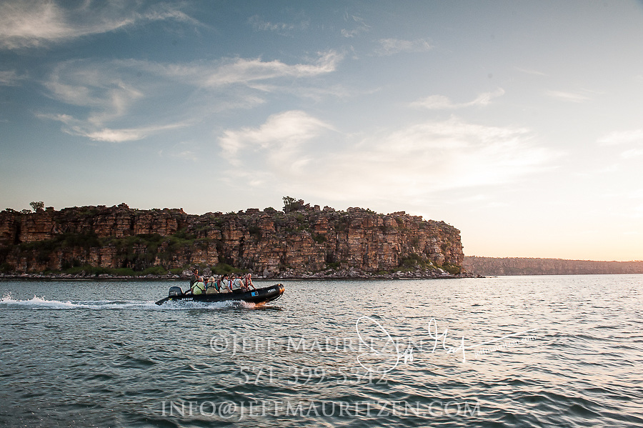 Expedition travelers aboard zodiac inflatable boats explore King George River in the Kimberley Region of Western Australia.