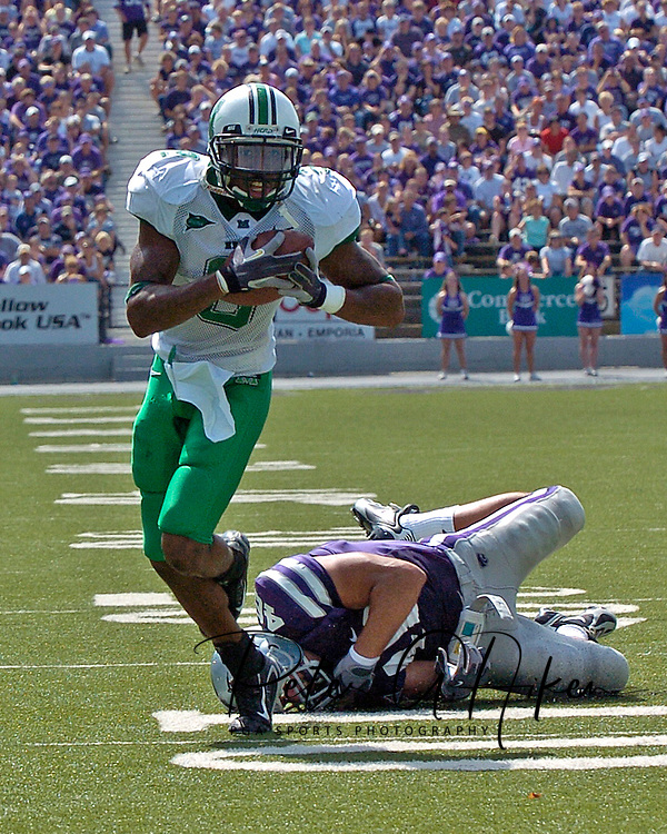 Marshall's James J.J. Johnson (8) brakes away for Kansas State's Brandon Archer (46) for a 18-yard blocked punt recovery touchdown in the second quarter, at Bill Snyder Family Stadium in Manhattan, Kansas, September 16, 2006.  The Wildcats beat the Thundering Herd 23-7.