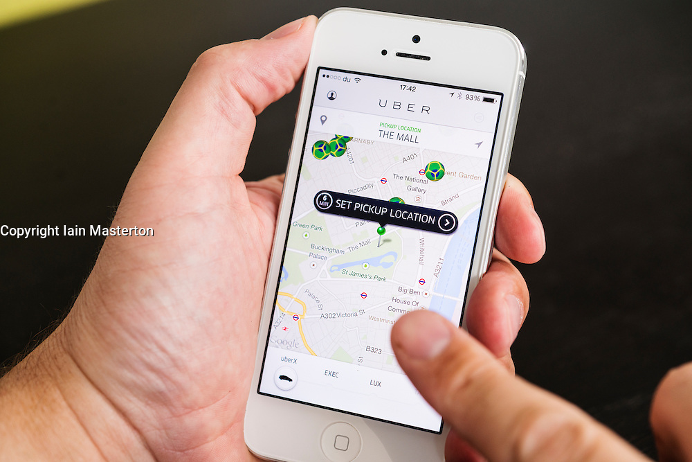 Detail of Uber taxi booking  app showing pickup locations in London on iPhone  smart phone