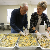 Salvation Army volunteers Mark Cayson and Dr. Roma Taylor prepare green bean casseroles for the Salvation Army's community wide Thanksgiving dinner.
