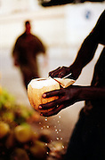 A man cuts a coconut in Mombasa
