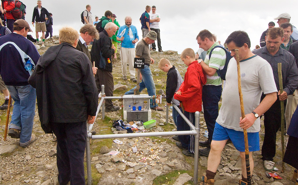 Pilgrims walk around St. Patricks Bed on croagh patrick during the annual pilgrimage which took place on Sunday. Pic: Michael Mc Laughlin