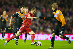 LIVERPOOL, ENGLAND - Wednesday, December 15, 2010: Liverpool's Milan Jovanovic and FC Utrecht's Gianluca Nijholt during the UEFA Europa League Group K match at Anfield. (Photo by: David Rawcliffe/Propaganda)