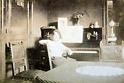 fading portrait of woman sitting by the piano 1930s