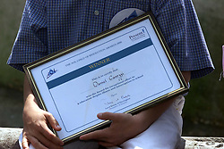 St Bartholomews Hospital, Child of Resolution Awards 2000. Daniel Carozzi holds on to his certificate, May 8, 2000. Photo by Andrew Parsons / i-images..
