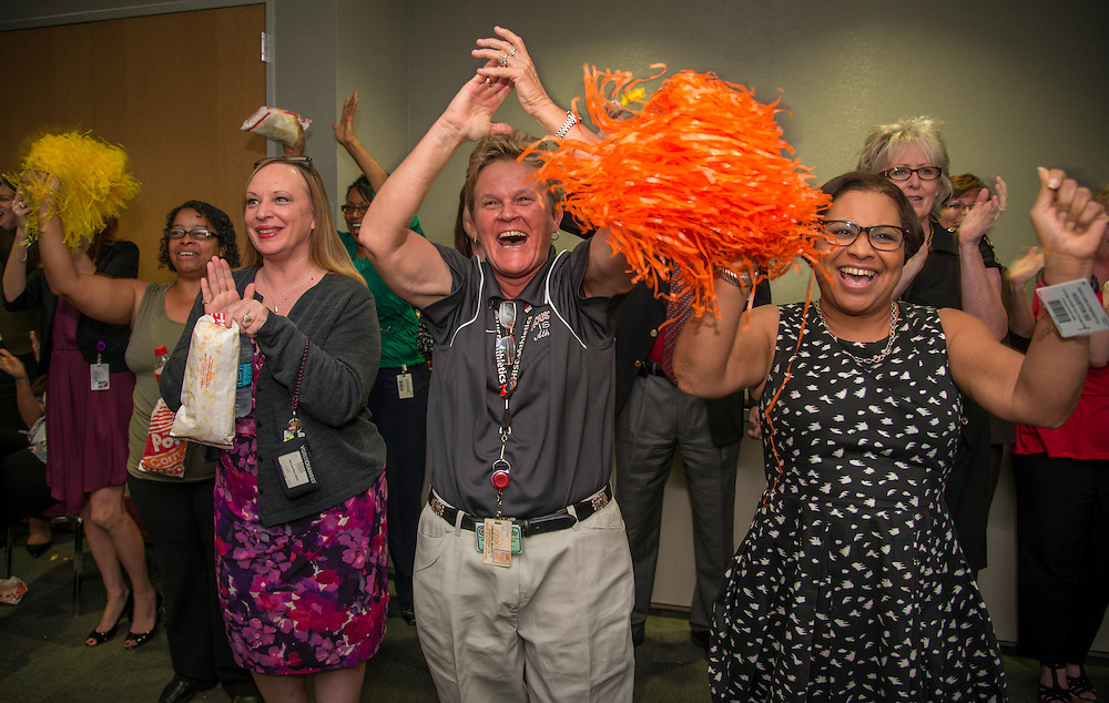 Central office staff watch and react to the announcement that HISD is the winner of the 2013 Broad Prize for Urban Education, September 25, 2013.