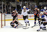 St. Louis Blues' Alex Pietrangelo (27) and Vladimir Tarasenko (91) celebrate as the puck shot by T.J. Oshie shoots past New York Islanders goalie Kevin Poulin (60) to tie the score 3-3 as Islanders' Andrew MacDonald (47) and Brock Nelson (29) react during an NHL hockey game on Saturday, Jan. 25, 2014, in Uniondale, N.Y. (AP Photo/Kathy Kmonicek)